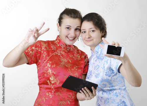 Happy women with mobile devices Poster