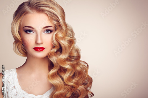 Fototapety, obrazy: Fashion portrait of young beautiful woman with jewelry and elegant hairstyle. Blonde girl with long wavy hair. Perfect make-up.  Beauty style model