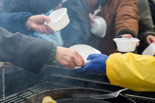 Fototapeta Warm food for the poor and homeless