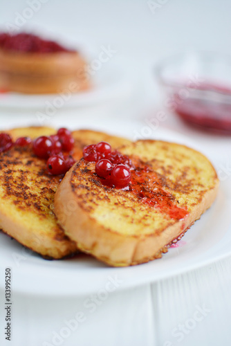 Homemade bread toast with berry jam on a white background
