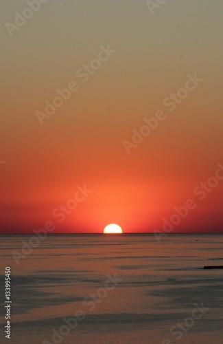 Garden Poster Brown sunset on the sea coast