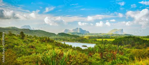 Valokuva  View of a lake and mountains. Mauritius. Panorama