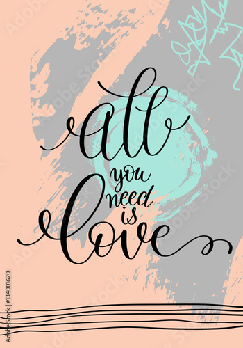 Photo  all you need is love hand written lettering on abstract painting