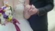 Closeup view of married couple holding hands. Bride and groom outdoor wedding video.