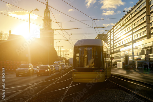 Poster  Modern electric tram yellow color on the streets of Berlin