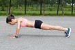 Push ups or press ups exercise by young woman