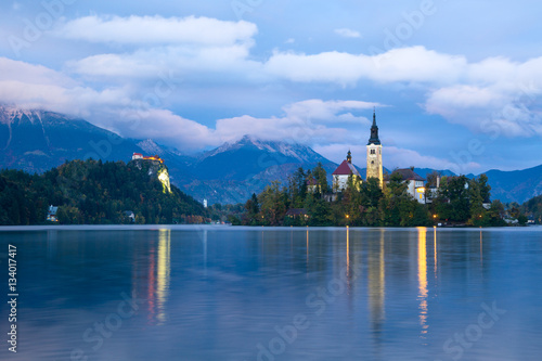 Fotobehang Natuur Park Church of Bled by night in Slovenia, Europe