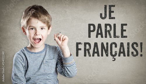 Fotografie, Obraz Je parle Francais, I speak French, Boy on grunge background writ