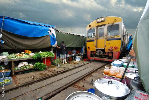 Fresh market on the railroad track, Mae Klong train station, Thailand