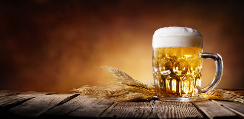 Fototapeta Beer With Wheat On Wooden Table
