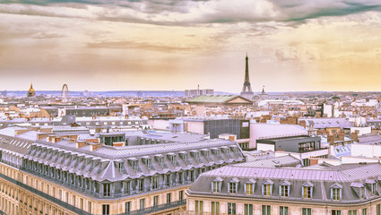 FototapetaCity landscape of Paris in pastel shades. Eiffel tower and old district near opera house at dramatic sky background. Summer sunny day scenery. France.