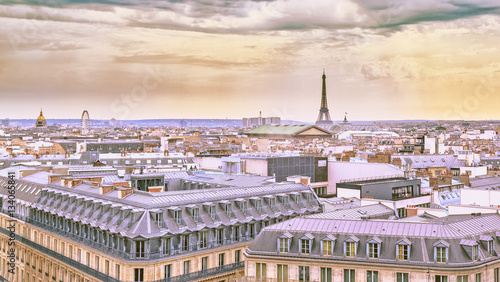 Poster de jardin Paris City landscape of Paris in pastel shades. Eiffel tower and old district near opera house at dramatic sky background. Summer sunny day scenery. France.