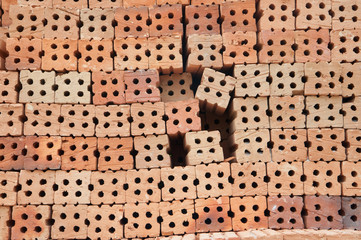 Lined outdoor stacking bricks on background.