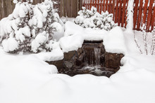 Snow Covered Outdoor Water Fea...