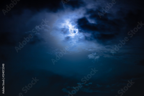 Canvas Print Nighttime sky with clouds and bright full moon with shiny.