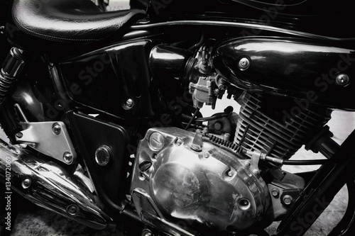 Canvastavla  black and white photo - The engine of vintage classic motorcycles