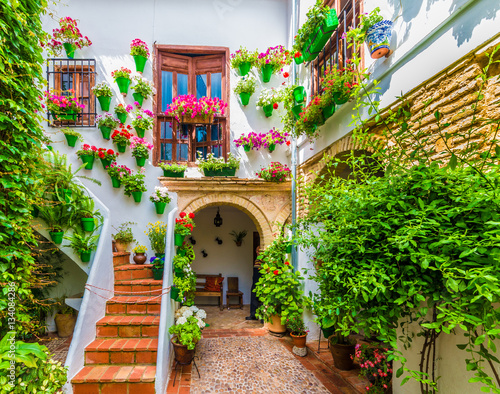 Traditional house and courts with flower in Cordoba, Spain