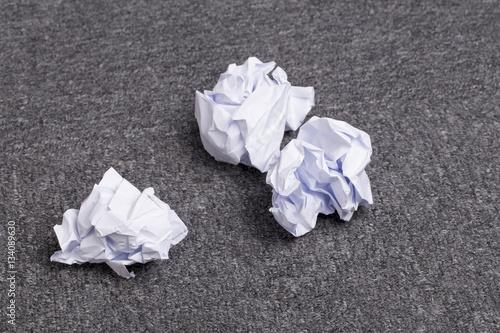 Fotografie, Obraz  Crumpled paper balls on the carpet
