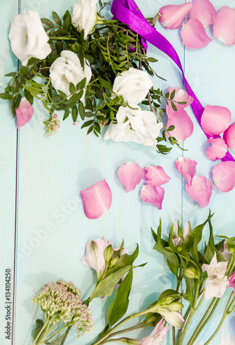 Flowers layout on white rustic background  a bouquet of