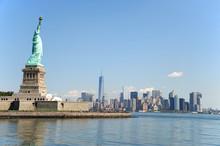 Statue Of Liberty On The Island And New York Manhattan Skyline
