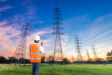 Electrical Engineer With High Voltage Electricity Pylon
