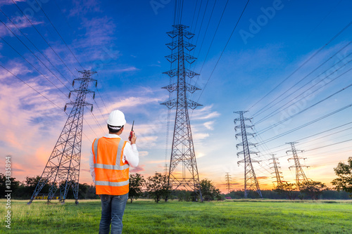Stampa su Tela Electrical engineer with high voltage electricity pylon