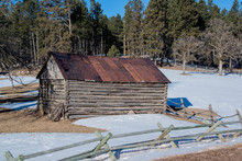 Historic Log Cabin With Handhewn Wooden Logs