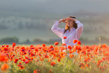 Girl At Blooming Poppy Field