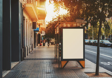 City Bus Stop With Empty Mock Up Banner For Your Advertising, Blank Billboard With Copy Space Area For Your Text Message Or Promotional Content, Public Information Board In Urban Setting