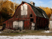 An Abandoned Old Red Barn In The Country.