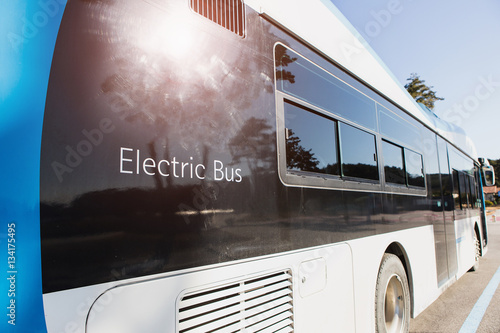 electric vehicle bus stands at the charger. Alternative sources of fuel.