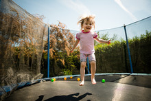 Child Jumping Trampoline