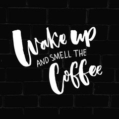 Fototapeta Napisy Wake up and smell the coffee. Inspirational quote about coffee and morning. Typography saying on black brick background