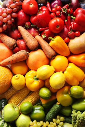 Ripe and tasty fruits and vegetables background Wall mural