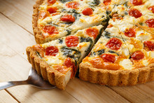 Vegetarian Homemade Pie, Quiche With Tomatoes, Spinach And Feta Cheese.