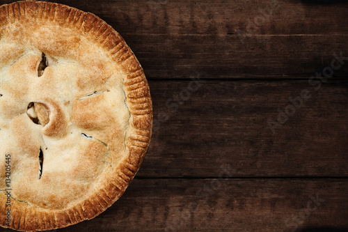 Homemade apple pie dessert shot from overhead over a dark wooden table top with room for copy space Canvas Print