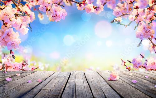 Fototapeta Spring Display - Pink Blossoms On Wooden Table  obraz