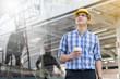 Foreman construction worker holding blueprint