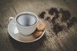 black coffee cup with cookies
