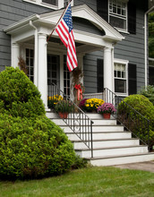U S Flag Hanging From Front Porch