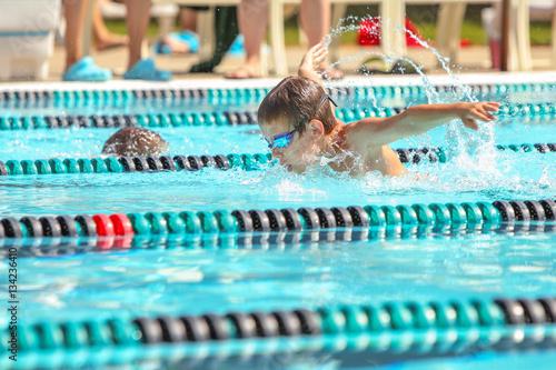 Boy swimming Butterfly in a race