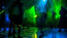 People Dancing On Defocused Bl...