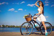 Beautiful Girl On The Beach With Cruiser Bicycle