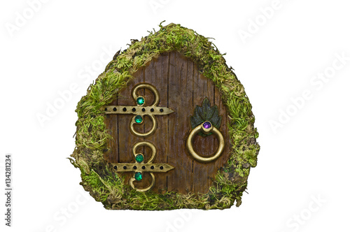 Fotografie, Obraz  Fairy door with moss on isolated background/Fairy door with moss, wood, brass or