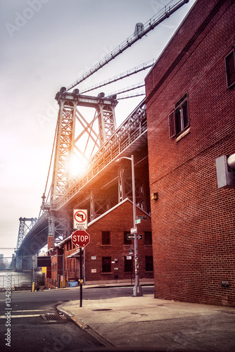 Photo  New York City street in Brooklyn with view to Williamsburg Bridge at sunset time