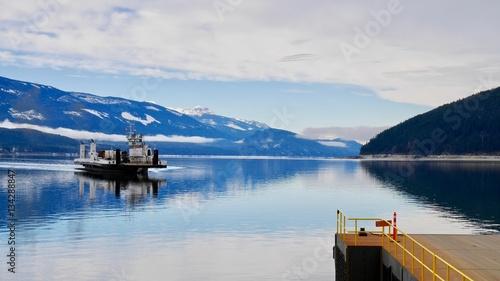Valokuva  Ferry boat on blue lake