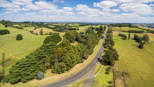Fotobehang Wijngaard Aerial panorama of beautiful countryside. Trees, pastures, fields, road.