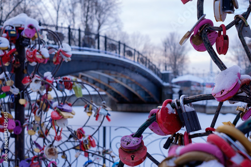 Photo Stands Roe Padlock as a symbol of happiness on a metal tree