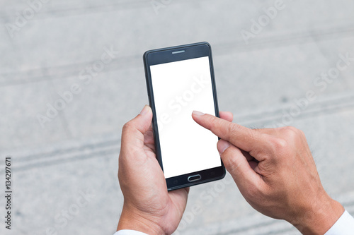 Fototapety, obrazy: The human hands holding the smartphone and touch on mobile screen