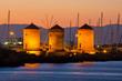 Leinwandbild Motiv Windmills in the port of Rhodes, Greece